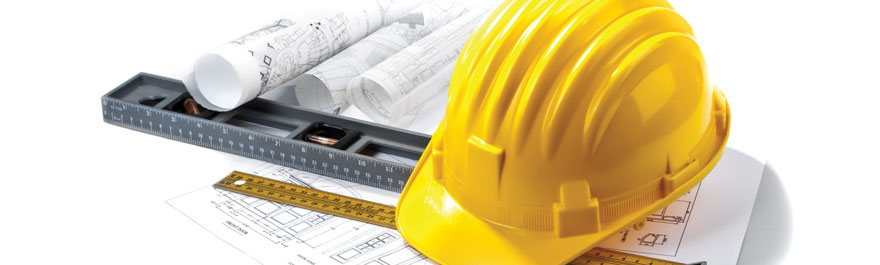 yellow hard hat blue prints level and ruler