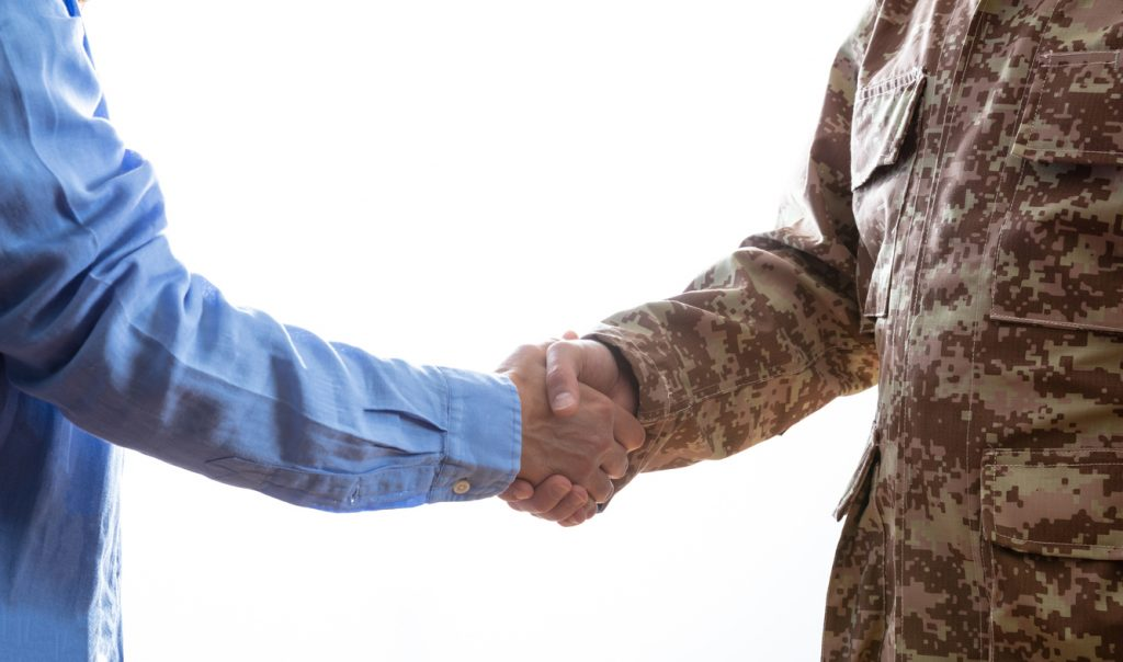 Civilian and Military men shaking hands