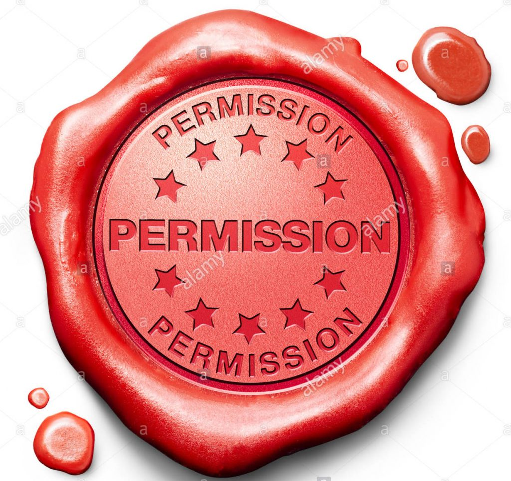 "Red wax seal with words ""permission"" stamped into it."