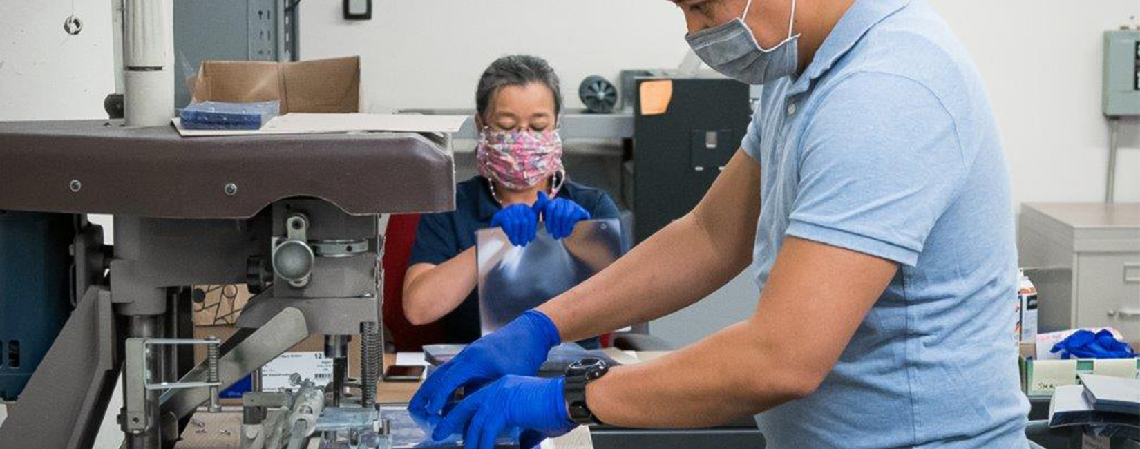 Workers at U of California San Francisco work on creating COVID face shields.