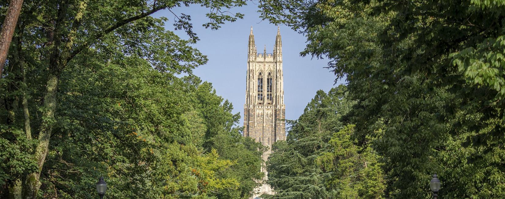 Photo of Duke University tower with trees.