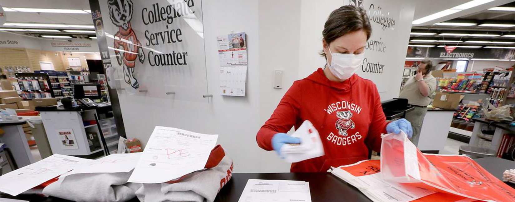U of Wisconsin student working at store.