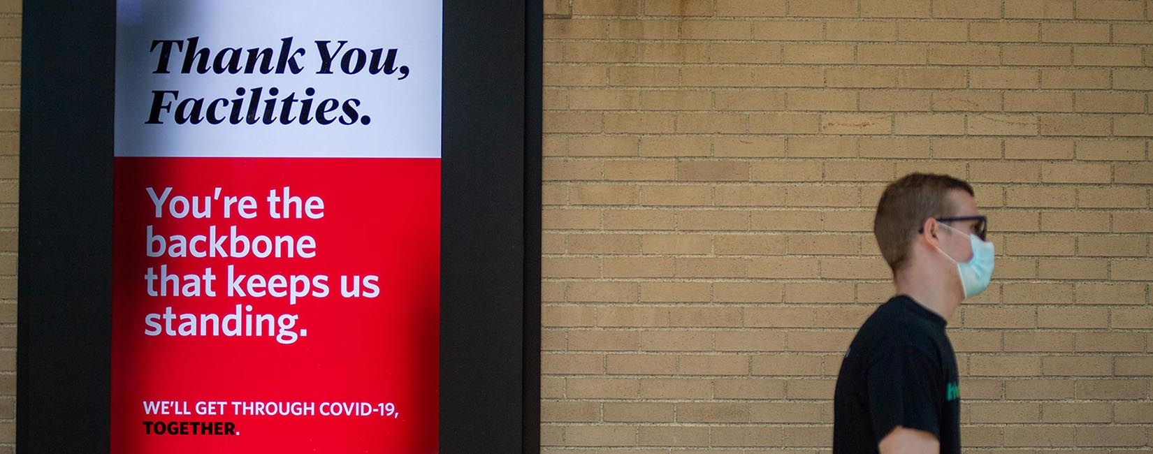 Boston University COVD sign supporting facilities workers.