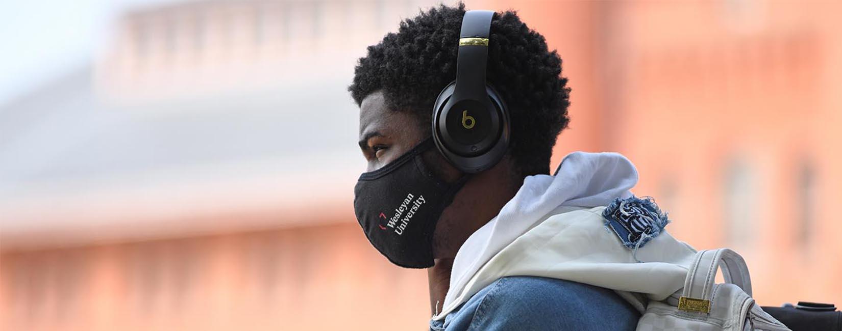 Wesleyan University student with COVID mask.